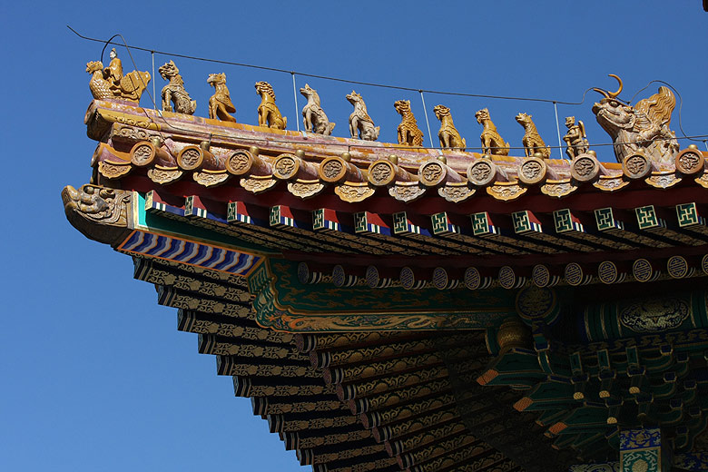 Beijing. Forbidden city. Figurines on the roof of Hall of Supreme Harmony